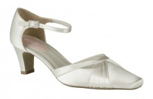 Cotton. Medium heel closed toe shoe with ankle strap.